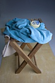 Soap and a bath towel on a stool
