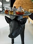 Tea break on the back of a animal figure