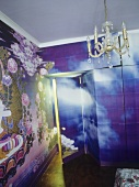 Small chandelier hanging in  bedroom with colour Xeroxed papered walls and built-in wardrobes