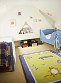 Children's white bedroom with painted beds, toy storage boxes, fun rug