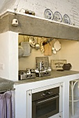 Brick kitchen unit with vent (country house style) and modern built-in appliances