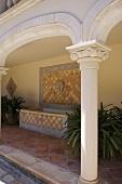Decorative column of veranda with tiled floor and bath