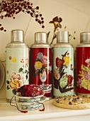 Collection of thermos flasks with floral pattern