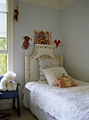 Cushions on single bed in blue bedroom