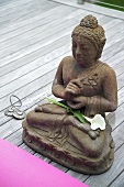 Buddha figure on decking