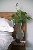 Leaf arrangement on built in bedside table