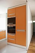 Modern kitchen with orange units