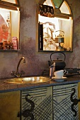 Metal sink in rustic kitchen