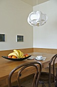 Pendant light above wooden table in modern dining room