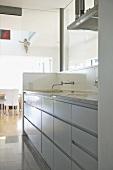 Sink set in fitted unit in modern kitchen