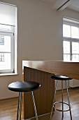 Stools with black seat at wooden breakfast bar