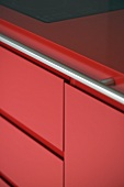Close up of red kitchen unit