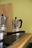 Steel coffee pots on ceramic hob