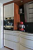 Modern kitchen with white units and integral drink dispenser