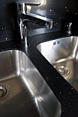 Chrome tap fitting above double kitchen sink