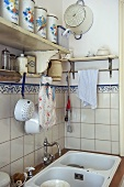 Corner of modern kitchen with tiled wall