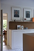 Built in white sideboard with artwork above