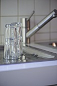 Drinking glasses on kitchen drainer