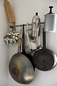 Cookware hanging from steel bar