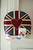 Cushion with Union Jack motif on upholstered armchair