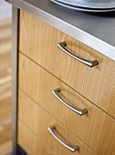 Close up of kitchen unit with wooden drawers