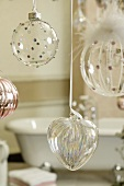 Hanging transparent Christmas ball ornaments and glass heart