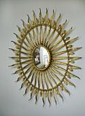 A detail of an ornate sun mirror,