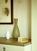 Pottery vases on wooden cupboard unit