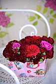 Red roses in a decorative box