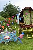 A picnic with a circus caravan