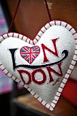A hanging heart-shaped cushion with the Union flag