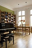 A piano in a living-room-cum-dining-room
