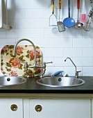 A work surface with two sinks and antique taps