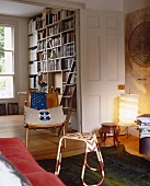A living room with an open door and a view of the book case
