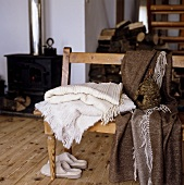 Wooden bench with blankets in a country house