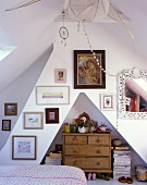 Bedroom in a converted attic with wood chest-of-drawers in a wall niche