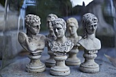 Chess figures made of stone under a bell jar
