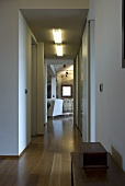 A hallway with open door and a view into a living room
