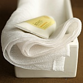 A tube of bamboo cream on a white towel