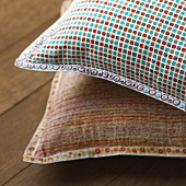 Two decorative cushions with different covers