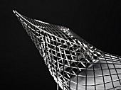 A diamond chair by Harry Bertoia - designer bucket chair made of metal