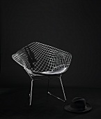 Diamond Chair by Harry Bertoia - designer bucket chair made of metal with a black hat