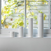 White vases in various sizes on a window sill