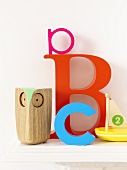 Toys and letters on a shelf