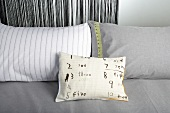 Decorative cushions with numbers and a measuring tape