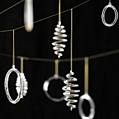 Christmas decorations hanging against a black background