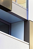Detail of a facade with a balcony in a contemporary apartment block