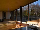 An open living room in a newly built house with a glass facade and a view
