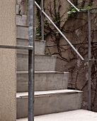 Concrete steps with a metal banister outside