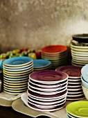Stacks of different coloured plates